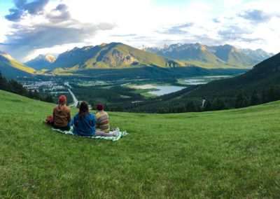Hostel friends take picnic and overlook Banff